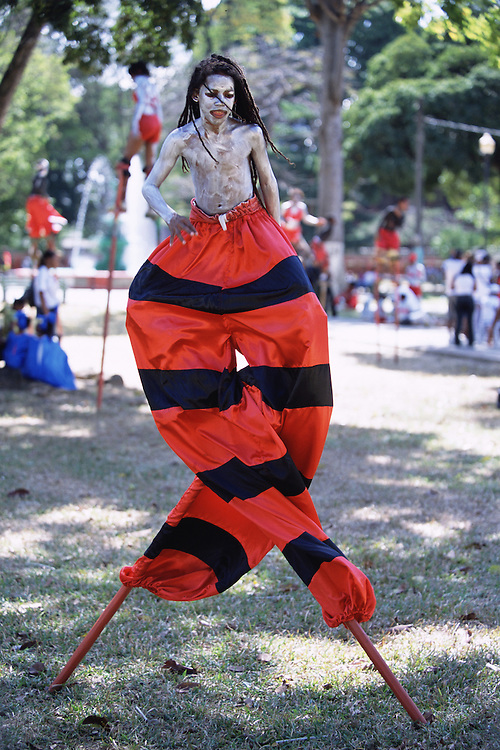 "Trinidad and Tobago ""MOKO JUMBIES: The Dancing Spirits of Trinidad"".(Sonny Ramatali shows off his skills at Woodford Square before joining the Junior Carnival parade. Costume design by Laura Anderson Barbata.).A photo essay about a stilt walking school in Cocorite, Trinidad..Dragon Glen de Souza founded the Keylemanjahro School of Art & Culture in 1986. The main purpose of the school is to keep children off the streets and away from drugs..He first taught dances like the Calypso, African dance and the jig with his former partner Cathy Ann Samuel.  Searching for other activities to engage the children in, he rediscovered the art of stilt-walking, a tradition known in West Africa as the Moko Jumbies , protectors of the villages and participants in religious ceremonies. The art was brought to Trinidad by the slave trade and soon forgotten..Today Dragon's school has over 100 members from age 4 and up..His 2 year old son Mutawakkil is probably the youngest Moko Jumbie ever. The stilts are made by Dragon and his students and can be as high as 12-15 feet. The children show their artistic talents mostly at the annual Carnival, which today is unthinkable without the presence of the Moko Jumbies. A band can have up to 80 children on stilts and they have won many of the prestigious prizes and trophies that are awarded by the National Carnival Commission. Designers like  Peter Minshall , Brian Mac Farlane and Laura Anderson Barbata create dazzling costumes for the school which are admired by thousands of  spectators. Besides stilt-walking the children learn the limbo dance, drumming, fire blowing and how to ride  unicycles..The school is situated in Cocorite, a suburb of Port of Spain, the capital of Trinidad and Tobago..all images © Stefan Falke"