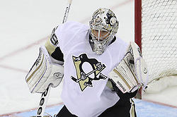 Mar 17; Newark, NJ, USA; Pittsburgh Penguins goalie Marc-Andre Fleury (29) makes a glove save during the first period of their game against the New Jersey Devils at the Prudential Center.