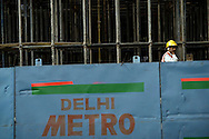 Construction workers lay reinforced beams during construction of Deli's Metro system in New Delhi, India February 23, 2009. Asia's third-largest economy will probably expand 7.1 percent in the year ending March 31 according to a statement by the country's statistics office in New Delhi.