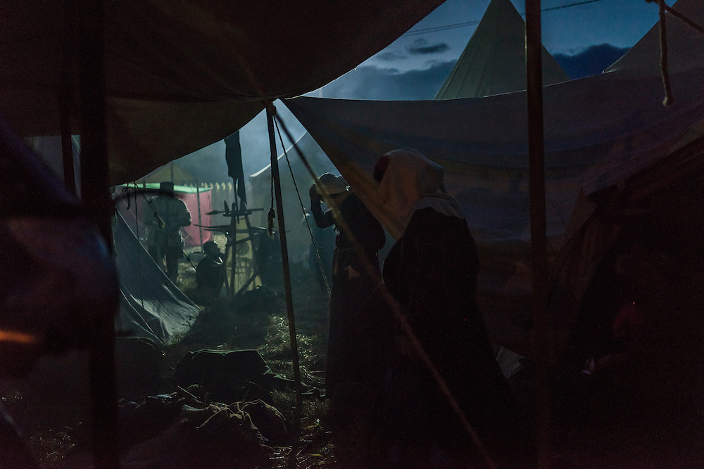 Men dressed in armor share a meal under a tent during a medieval festival on Saturday, September 24, 2016 in Mstislavl, Belarus.