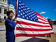 04 MAY 2017 - ST. PAUL, MN: Women hold the American flag on the Capitol steps during a prayer service at the Minnesota State Capitol. About 200 people gathered on the lawn in front of the Minnesota State Capitol in St. Paul for a noon time prayer service on the National Day of Prayer. Similar services were held across the country.     PHOTO BY JACK KURTZ