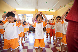 Pupils exercising in a school of Mekong Delta area, Vietnam, Southeast Asia