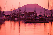 Alaska. Sitka. Sunset on the Sitka channel and Thomasen Harbor with Mt Edgecomb in background.
