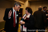Tommy Reynolds (left) visits with Reba Bland at Chamber of Commerce Eggs and Issues at Oxford Conference Center on Monday, January 4, 2010