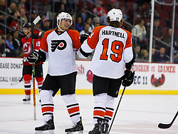 Oct 24, 2008; Newark, NJ, USA; Philadelphia Flyers right wing Joffrey Lupul (15) and Philadelphia Flyers left wing Scott Hartnell (19) celebrate Hartnell's empty net goal during the third period at the Prudential Center. The Flyers defeated the Devils 6-3.