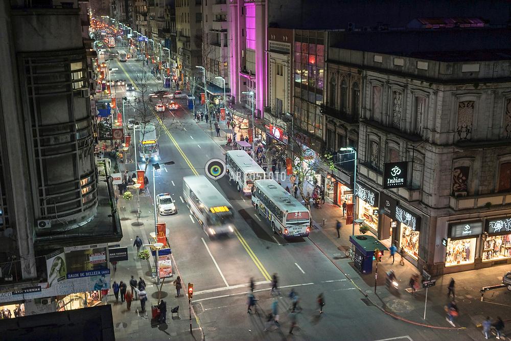 Montevideu, Uruguai, 2016. Avenida 18 de Julho (Avenida 18 de Julio),eh a avenida mais importante da cidade. Em 18 de Julho de 1830 foi promulgada a primeira Constitui&ccedil;&atilde;o do pais.  Comeca na Plaza Independencia, nos limites da Ciudad Vieja (Cidade Velha), atravessa os bairros Centro e Cordon e termina no Obelisco de Montevideu em Tres Cruces, onde se encontra com Artigas Boulevard. Apesar de nao ser a avenida mais larga ou mais longa da cidade, eh considerado como o mais importante de Montevideu, tanto como um centro comercial e por causa das muitas atracoes turisticas ao longo do seu comprimento.  Esquina com Convencion  = Avenida 18 de Julio, or 18 de Julio Avenue, is the most important avenue in Montevideo, Uruguay. It is named after the date the first Constitution of Uruguay was written: July 18, 1830.<br /> It starts from Plaza Independencia at the limits of the Ciudad Vieja (the Old City), crosses the barrios Centro and Cord&oacute;n and ends at the Obelisk of Montevideo in Tres Cruces, where it meets Artigas Boulevard. Although not the widest or longest avenue of the city, it is considered as the most important of Montevideo, both as a commercial center and because of the many tourist attractions along its length.<br /> Comeca na Plaza Independencia, nos limites da Ciudad Vieja (Cidade Velha), atravessa os bairros Centro e Cordon e termina no Obelisco de Montevideu em Tres Cruces, onde se encontra com Artigas Boulevard. Apesar de nao ser a avenida mais larga ou mais longa da cidade, eh considerado como o mais importante de Montevideu, tanto como um centro comercial e por causa das muitas atracoes turisticas ao longo do seu comprimento.  Esquina com Convencion  = Avenida 18 de Julio, or 18 de Julio Avenue, is the most important avenue in Montevideo, Uruguay. It is named after the date the first Constitution of Uruguay was written: July 18, 1830.<br /> It starts from Plaza Independencia at the limits of the Ciudad Vieja (the Old City), crosses the