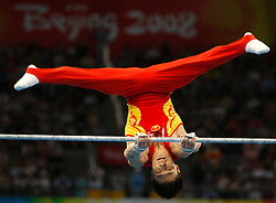 China's Li Xiaopeng competes on the high bar for the artistic gymnastics men's team during the Olympic games in Beijing, China, 12 August 2008. The Chinese won the gold medal for the event with Japan and United States taking silver and bronze respectively.