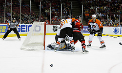 Mar 30, 2007; East Rutherford, NJ, USA; The puck skips past New Jersey Devils left wing Zach Parise (9) during the third period at Continental Airlines Arena in East Rutherford, NJ.