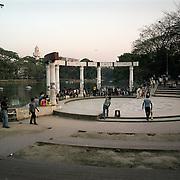 Young people play cricket in Dhanmondi Lake Park in Dhaka.
