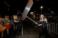 Two Halloween cosplay revelers as anime characters with big swords