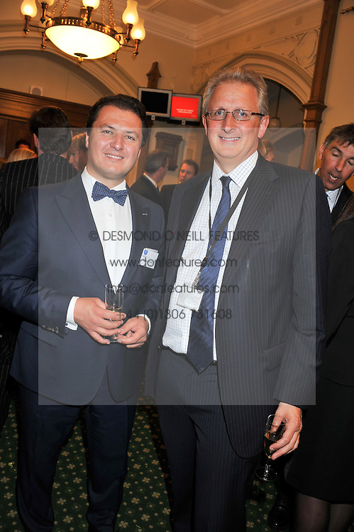 Left to right, STEFAN DARABUS and ANDREW BINGHAM MP at a reception for The Mirela Fund in partnership with Hope and Homes for Children hosted by Natalie Pinkham in The Churchill Room, House of Commons, London on 30th April 2013.