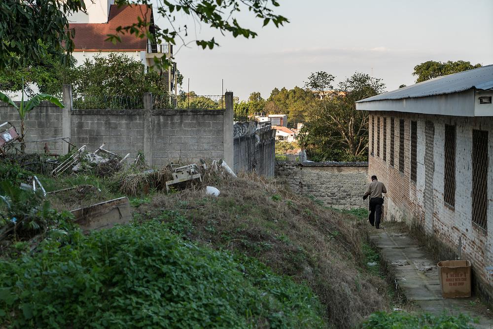 A security guard returns to work along a path behind Occidente Hospital in Santa Rosa de Copan, Copan, Honduras on Feb. 8, 2017. Photo Ken Cedeno