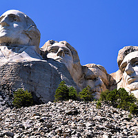 Mount Rushmore Near Keystone, South Dakota, in the Black Hills<br /> The cost of carving four, 60 foot president heads into Mount Rushmore from 1927 until 1941 was $10,000 shy of one million. This ambitious monument would have cost more if the original plans had been implemented to sculpture the bi-partisan foursome from the waist up. Susan B. Anthony almost joined this boys&rsquo; club. However, the congressional approval was overridden in 1937.