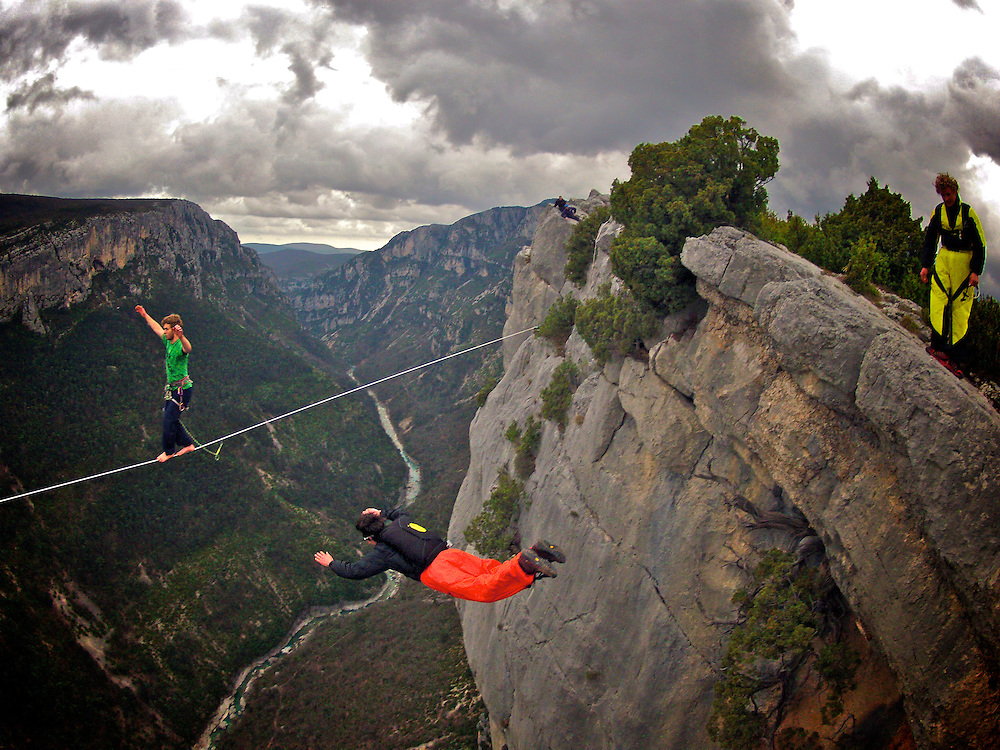 Nadeem AL-Kafaji onsighting an highline in Gorges du Verdon's sector of  Dalles Grises, France, while Tancrede Melet throws himself to a 300m cliff BASE jump. MIch Kemeter wait patiently his time to jump...© 2012 Pedro Pimentel