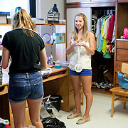 08/29/2012 - Medford/Somerville, Mass. -  Roommates Kelly Souza, A16, right, and Julia Rowe, A16, set up their room in Miller Hall on the morning of Wednesday, Aug. 29, 2012. (Kelvin Ma/Tufts University)