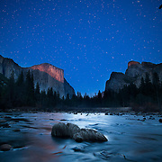Yosemite National Park at twilight with el Capitan and Cathedral Rocks in the background from Merced River