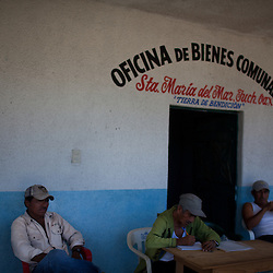Members of the Bienes Comunales of Santa Maria signed an agreement with windmill companies because they felt they had no other opportunities in the area. Here they are taking notes during an interview. ..The Isthmus of Tehuantapec, long a center for indigenous land ownership, is now embroiled in a land dispute over wind farm land.