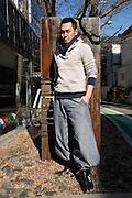 YOSHIYUKI OGATA fashion designer in front of his shop in Harajuku, Tokyo