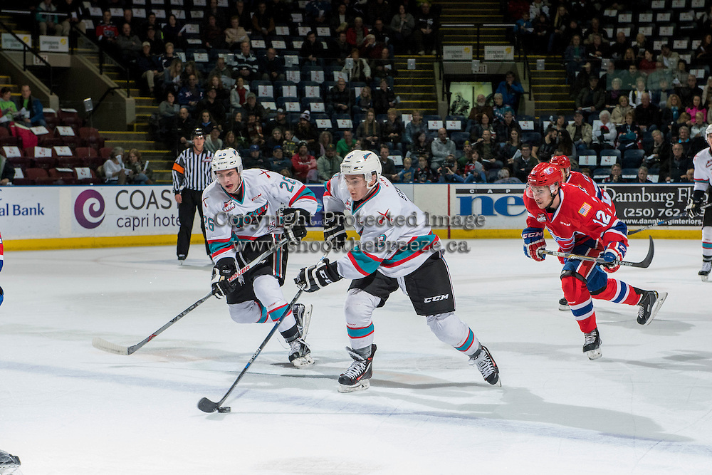 KELOWNA, CANADA - FEBRUARY 5: Cole Linaker #26 and Riley Stadel #3 of Kelowna Rockets skate up the ice with the puck against the Spokane Chiefs on February 5, 2016 at Prospera Place in Kelowna, British Columbia, Canada.  (Photo by Marissa Baecker/Shoot the Breeze)  *** Local Caption *** Cole Linaker; Riley Stadel;