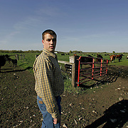 land - ames, may 3 -- Kyle Moss, a sophomore ag business major at Iowa State wants to go into cattle farming part time and is working on a plan that will allow him to get around the high cost of acquiring land.  Moss recently paid a visit to ISU's experimental herd south of the campus.  photo by david peterson    Photo by David Peterson