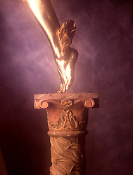 Symbolic gold covered leg of Mercury Icon iconic