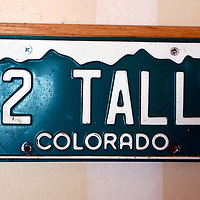 An old automobile license plate hangs in the garage of the Kotzians in Thornton, Colorado March 25, 2010.  Barb and Chris Kotzian are achondroplasia dwarfs. Preferring to be called little persons both are active in the Little People of America, the only dwarfism support organization that includes all 200+ forms of dwarfism.  REUTERS/Rick Wilking (UNITED STATES)
