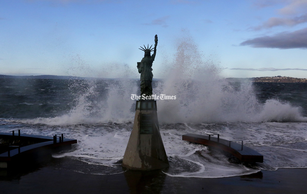 Combine high tide and a strong wind out of the west and the result is big waves crashing against the seawall in West Seattle in front of Lady Liberty along Alki Avenue S.W. (Alan Berner / The Seattle Times)