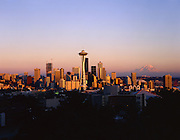 AA00563-02...WASHINGTON  - A 1985 image of the Seattle skyline at sunset with Mount Rainier in the distance.