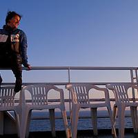 Europe, Norway. (MR)Leather-clad biker Annbjørg Bakkebø on ferry, Trondheim, Norway