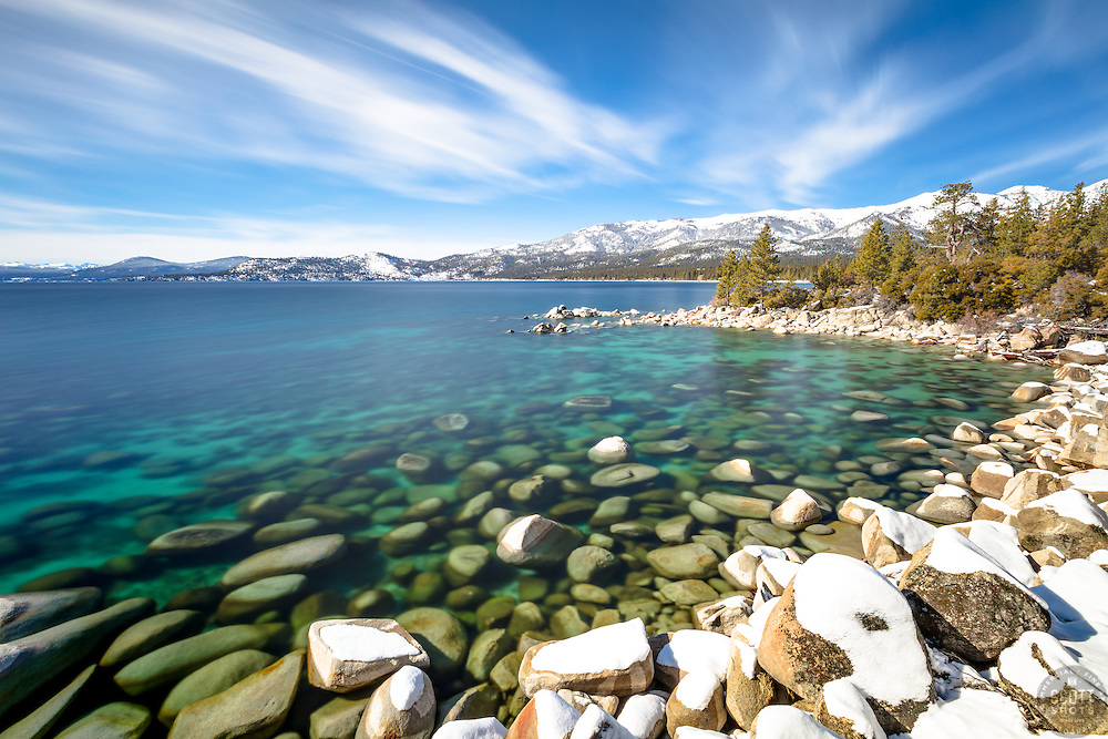"""Boulders at Lake Tahoe 51"" - Long exposure photograph of snow covered boulders and the aqua blue waters of Lake Tahoe, shot near Hidden Beach."