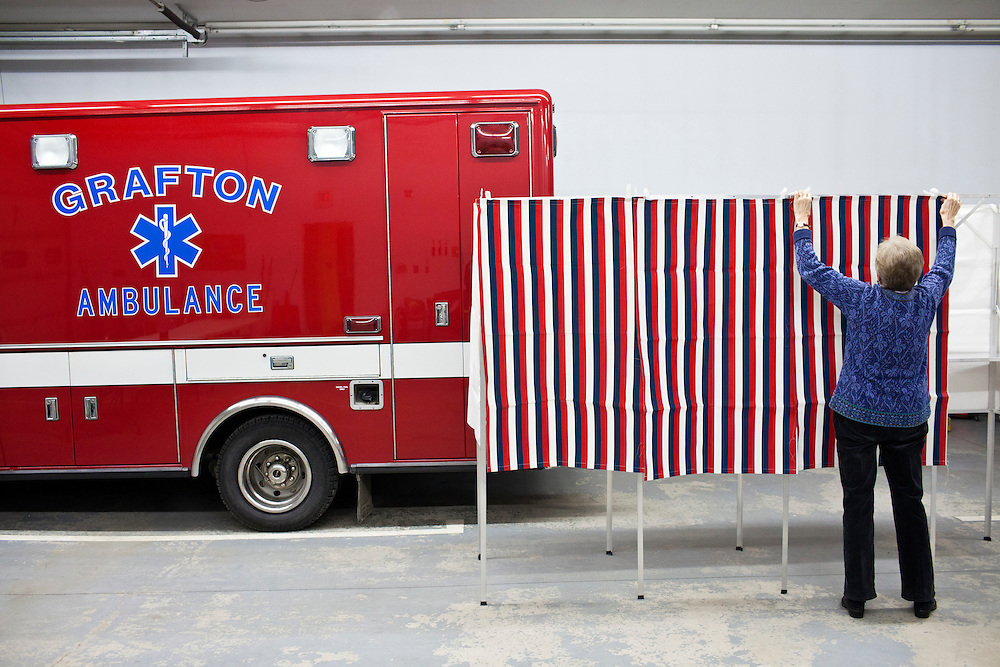 Dorothy Cambell assembles a voting booth for primary voting at the Grafton Fire Station on Tuesday, January 10, 2012 in Grafton, NH. Brendan Hoffman for the New York Times