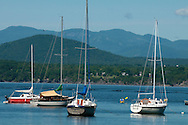 Kayakers and sailboats on Lake Champlain, Charlotte, Vermont