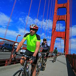 Riding Bicycles over the Golden Gate Bridge, San Francisco, California