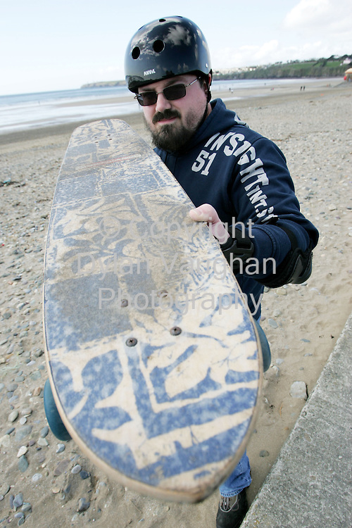 11/4/2005.Irish Independent Features.Greg Fewer pictured with his longboard in Tramore in County Waterford..Picture Dylan Vaughan