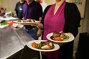 Ballard Elks Club. Kitchen staff preparing steak dinners for diners at the ceremonial dinner for grant recipients. <br /> <br /> Matt Lutton / Boreal Collective for Buzzfeed