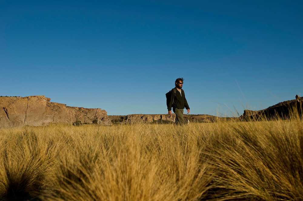Matias Soriano, 41, hikes through Malaspina Canyon on his family's ranch in Patagonia, Argentina. Soriano manages the 250,000 Bahia Bustamante ranch, and has been the prime influence in making the ranch sustainable. He carefully tracks the land use, has converted much of their power supply to solar panels, and tirelessly works to protect the environment and wildlife that live at Bahia Bustamante.