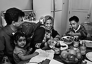 Hadia and Raheem are laughing when Hadia says she thinks Raheem looks funny without his mustache and should grow it back. Saleh tells Hadia she should open an Arabic Restaurant. Hadia prepares a dinner for her newly reunited family in their Oakland apartment during her first week since she fled Iraq. Hadia Khanfoosh and her children fled Iraq and came to America to join her son, Saleh, and her husband, Raheem after being apart for over a year. Through an international medical intervention, Saleh Khalaf, 10, on the brink of death after a bomb explosion, was brought from Iraq to Oakland Children's Hospital along with his father, Raheem in November 2003. They were granted political asylum when it became unsafe for them to return to Iraq.