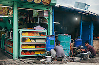 Workers washing dishes outside their sweet shop at Dhalpur Ground, Kullu. Kullu Dussehra is the Dussehra festival observed in the month of October in Himachal Pradesh state in northern India. It is celebrated in the Dhalpur maidan in the Kullu valley. Dussehra at Kullu commences on the tenth day of the rising moon, i.e. on 'Vijay Dashmi' day itself and continues for seven days. Its history dates back to the 17th century when local King Jagat Singh installed an idol of Raghunath on his throne as a mark of penance. After this, god Raghunath was declared as the ruling deity of the Valley.