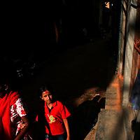 A mother and daughter walking the backstreets of Kathmandu on June 15, 2006. (Photo/Scott Dalton)