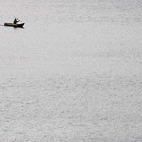 Man in boat on Lake Atitlán in Santiago Atitlán, Guatemala on Tuesday, Nov. 1, 2005.