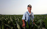 **hold for business**Jon Nicoson, a farmer in Cory, Ind., poses for a portrait in a corn field on his 1700-acre farm Monday, June 18, 2007. (AP Photo/AJ Mast)