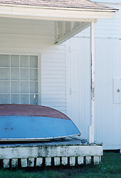 Hand painted rowboat on a porch in Maine