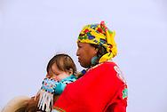 Crow Fair, Parade, Crow Indian Reservation, Montana, grandmother carries grandson