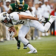 SHOT 9/19/15 6:33:31 PM - Colorado's Nelson Spruce #22 looks for extra yards after the catch against Colorado State during the Rocky Mountain Showdown at Sports Authority Field at Mile High in Denver, Co. Colorado won the game 27-24 in overtime. (Photo by Marc Piscotty / © 2015)