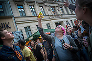 """01/05/2015 – Berlin, Germany: A girl fires a confetti toy gun during the """"Myfest""""  street festival in Kreuzberg during  Workers Day. """"Myfest"""" takes place in district SO 36, the traditional centre of riots that usually occur during May Day celebrations and it was organized to decreased the violence caused by Revolutionary May Day Demonstrations. The radical left wing criticises such events claiming that it is pretended to pacify social conflicts and to ban radical demonstrations.  The International Workers Day is a celebration of laborers and the working classes that is promoted by the international labor movement, anarchists, socialists, and communists and occurs every year on May Day. (Eduardo Leal)"""