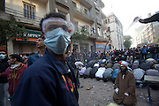 A Muslim cleric tries to conduct prayers in the middle of  clashes between anti- government protestors and Egyptian security forces . Violence continued  for the fifth day nearby Tahrir Square in Cairo , Egypt November 23,2011.  (Photo by Heidi Levine/Sipa Press).