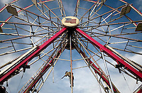 JEROME A. POLLOS/Press..Carnival workers assemble the ferris wheel at the Grant County Fair midway on Monday in Moses Lake, Wash. in preparation for the fair that runs through Saturday. The Kootenai County Fair will open on Wednesday.