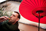High Montgomery (left) journalist for The Independent, tries street food on sale in Kyoto, Japan, on Friday 13th January 2012.