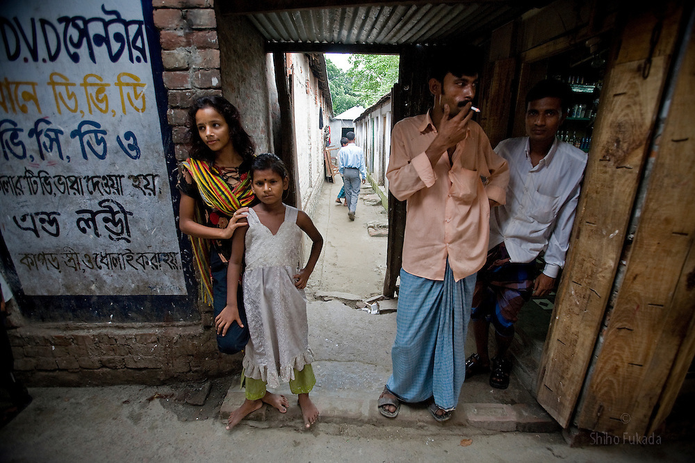 Nodi,14, left, and cousin Suma, 8, are seen at brothel in Tangail, Bangladesh. Nodi run away from home after falling in love with a Hindu boy and ended up in the brothel with her sister. Suma's mother is a sex worker. <br /> The majority of the 20,000 to 30,000 female sex workers in Bangladesh are victims of trafficking.
