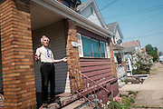 Tony Gennaro, 84, stands on the front porch of his home in West Aliquippa. Gennaro, a weightlifter who held both national and world titles is also a former steelworker that worked in the blooming mill at the J&L facility in Aliquippa.